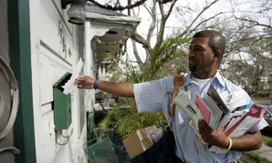 Mailman Randy Ramie delivers mail Feb. 23, 2006, in New Orleans.