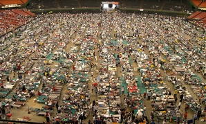The floor of Houston's Astrodome is covered with cots and evacuees from hurricane-ravaged New Orleans Friday, Sept. 2, 2005.