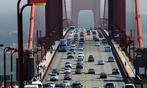 Drivers travel across the Golden Gate Bridge between San Francisco and Marin County. California requires auto insurers to charge motorists mostly based on driving record, rather than on occupation, address or education level.
