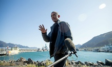 President Obama speaks to reporters before taking a boat tour at the Kenai Fjords National Park on Sept. 1 in Seward, Alaska.