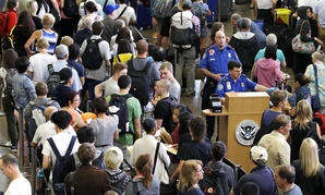 Aug. 11, 2015, at Seattle-Tacoma International Airport, TSA agents are surrounded by travelers in lines that snake around the airport.