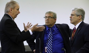 Illinois Auditor General William Holland, left, Illinois Rep. Frank J. Mautino, D-Spring Valley, center, and Illinois Rep. Fred Crespo, D-Steamwood, right, talk at the state Capitol on Tuesday, May 6, 2014, in Springfield, Ill.