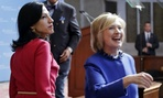 Huma Abedin, left, an aide to Hillary Clinton, watches Clinton greet members of the audience following a speech at the David N. Dinkins Leadership and Public Policy Forum New York last spring.