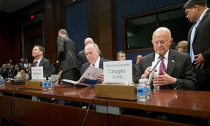 FBI Director James Comey, CIA Director John Brennan and Director of National Intelligence James Clapper prepare to testify on Capitol Hill Thursday.