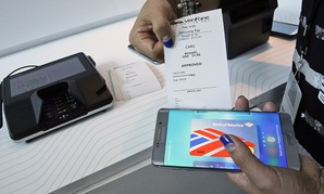 A product expert demonstrates the Samsung Pay during a presentation, Thursday, Aug. 13, 2015, at Lincoln Center in New York.