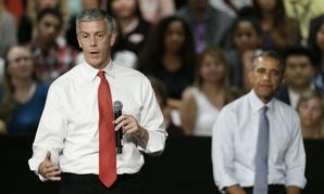 Education Secretary Arne Duncan, left, speaks as President Obama looks on Sept. 14 in Des Moines, Iowa.