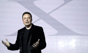 Elon Musk, CEO of Tesla Motors Inc., introduces the Model X car at the company's headquarters Tuesday, Sept. 29, 2015.