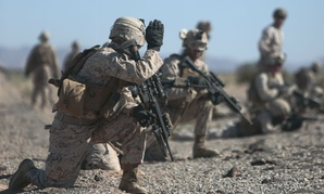 Marines set up perimeter security during a fast rope exercise at Auxiliary Airfield 2, Yuma, Ariz.