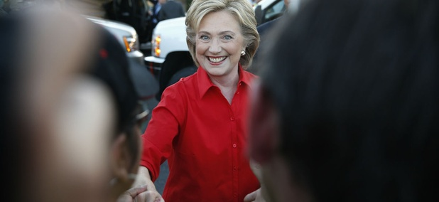 Clinton shakes hands during a rally in Las Vegas Monday.