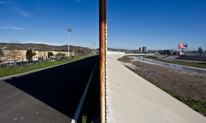 A portion of a border fence near San Ysidro, California is seen in 2012. The United States is on the left with Mexico