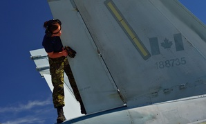 A technician performs post-flight checks on a Royal Canadian Air Force CF-188 Hornet in 2013.