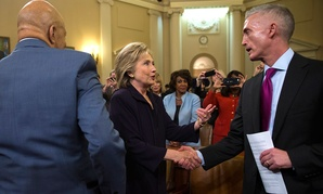 Hillary Clinton shakes hands with House Select Committee on Benghazi Chairman Rep. Trey Gowdy at the conclusion of Thursday's hearing as Rep. Elijah Cummings looks on.
