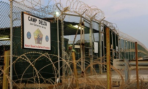 Soldiers assigned to the 115th Military Police Company of the Rhode Island Army National Guard stand guard at a sally port inside Camp Delta at Joint Task Force Guantanamo in 2010