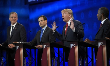 Republican presidential contenders (from left) Jeb Bush, Marco Rubio and Ben Carson look on as Donald Trump answers a question during the debate.
