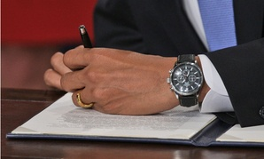 Obama signs an executive order pledging transparency on his first day in office.