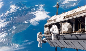 NASA and ESA astronauts conduct a spacewalk in 2006.