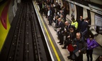 London travelers wait for a train at Waterloo Underground Station in 2014.
