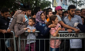 Syrian refugees wait to be registered by police in the southern Serbian town of Presevo in September.