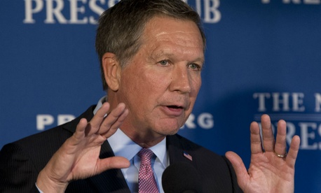 """Republican presidential contender Ohio Gov. John Kasich called for a new agency to promote """"Judeo-Christian Western values"""" abroad."""