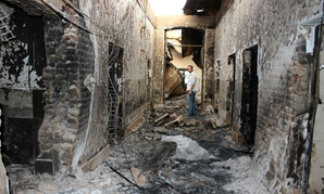 An employee of Doctors Without Borders stands inside the charred remains of their hospital after it was hit by a U.S. airstrike in Kunduz, Afghanistan.