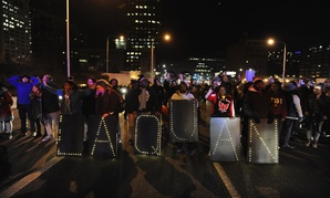 Protesters march during a demonstration for 17-year-old Laquan McDonald on Tuesday in Chicago. Police Officer Jason Van Dyke was charged with first-degree murder hours before the city released a video of the shooting.