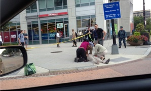 A victim of the September 2013 Navy Yard shootings receives medical attention.