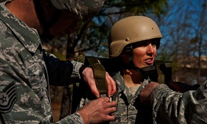Air Force Staff Sgt. Christine Phillips has her parachute harness tightened during a training exercise in 2013.