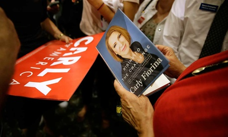 An audience member holds a book as she waits to get it signed by Republican presidential candidate Carly Fiorina in September in Iowa.
