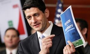 Then-House Budget Committee Chairman Rep. Paul Ryan, R-Wis., holds up a copy of his budget plan in 2012. Ryan made his name proposing budget plans aimed at tackling the nation's long-term debt.