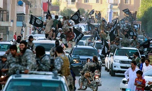 Islamic State militants parade in Syria in 2014.