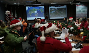 Volunteers help answer phone calls and letters to Santa in 2009 at NORAD.