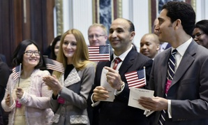 Immigrants take the Oath of Allegiance at a naturalization ceremony in Washington in October.