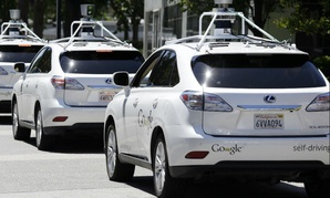 FILE - This May 13, 2014 file photo shows a row of Google self-driving Lexus cars at a Google event outside the Computer History Museum in Mountain View, Calif.