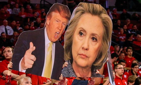 Fans hold cutouts of 2016 candidates during a Nebraska basketball game in November.