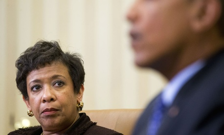 Attorney General Loretta Lynch listens as Obama speaks about actions to curb gun violence.