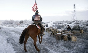 A supporter of the group occupying the Malheur National Wildlife Refuge in Oregon rides his horse at the refuge Friday.