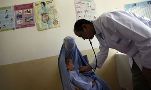 A doctor examines a child at a health clinic in Kabul, Afghanistan.