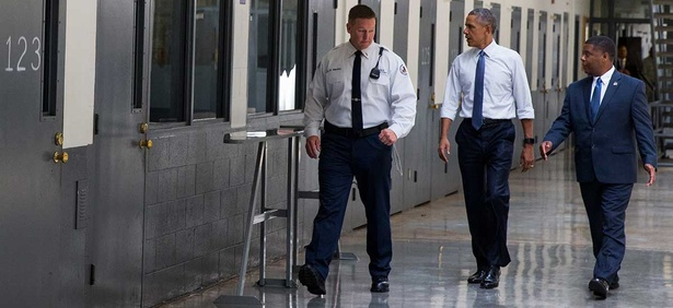 Barack Obama is led on a tour by Bureau of Prisons Director Charles Samuels, right, and correctional officer Ronald Warlick during a visit to Oklahoma's El Reno Federal Correctional Institution in July.
