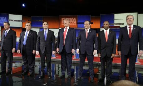 Republican presidential candidates, from left, Ohio Gov. John Kasich, New Jersey Gov. Chris Christie, Sen. Marco Rubio, R-Fla., businessman Donald Trump, Sen. Ted Cruz, R-Texas, retired neurosurgeon Ben Carson and former Florida Gov. Jeb Bush.
