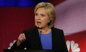 Clinton squares off with the other Democratic candidates in Sunday's presidential debate.