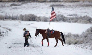 Cowboy Dwane Ehmer walks his horse at the Malheur National Wildlife Refuge during the occupation.
