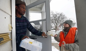 The Michigan National Guard hands out water filters and test kits in Flint.