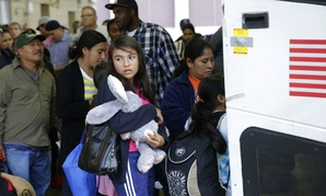 Immigrants from El Salvador and Guatemala who entered the United States illegally board a bus after they were released from a family detention center in San Antonio, Texas.