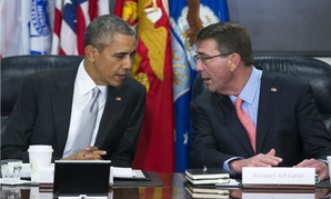 President Barack Obama talks with Defense Secretary Ash Carter during a meeting with the National Security Council in December at the Pentagon.