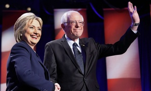 Democratic presidential candidates Hillary Clinton and Bernie Sanders pose for a photo before their debate Thursday.
