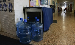 Bottles of drinking water are seen in a hallway at St. Mary's Academy in Hoosick Falls, N.Y.