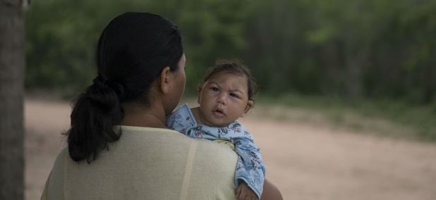 Josiane da Silva holds her son Jose Elton, who was born with microcephaly, outside her house in Alcantil, Paraiba state, Brazil. Zika is thought to cause birth defects.