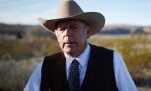 Rancher Cliven Bundy stands along the road near his ranch in January after his son was arrested.