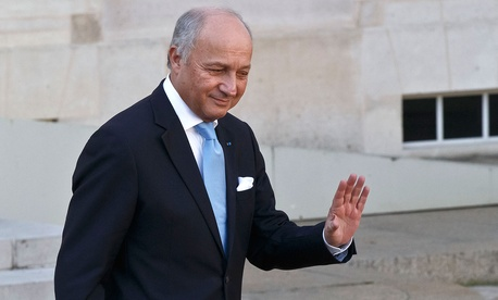 French Foreign Minister Laurent Fabius leaves the weekly cabinet meeting at the Elysee Palace Wednesday.