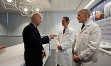 Joe Biden, left, gestures while speaking with Dr. Bruce L. Levine PH.D., center, and Dr. Carl H. June M.D., in the Abramson Cancer Center at the University of Pennsylvania in January.